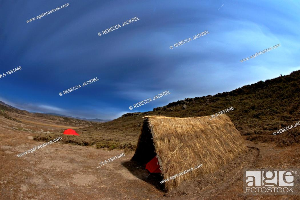 Stock Photo: A small grass shelter and tent in the Web Valley, Bale Mountains, Ethiopia.