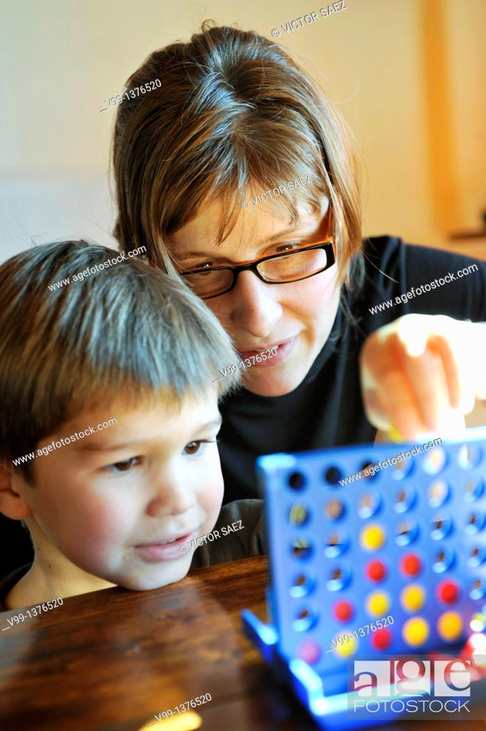 Stock Photo: Mother and child playing together.