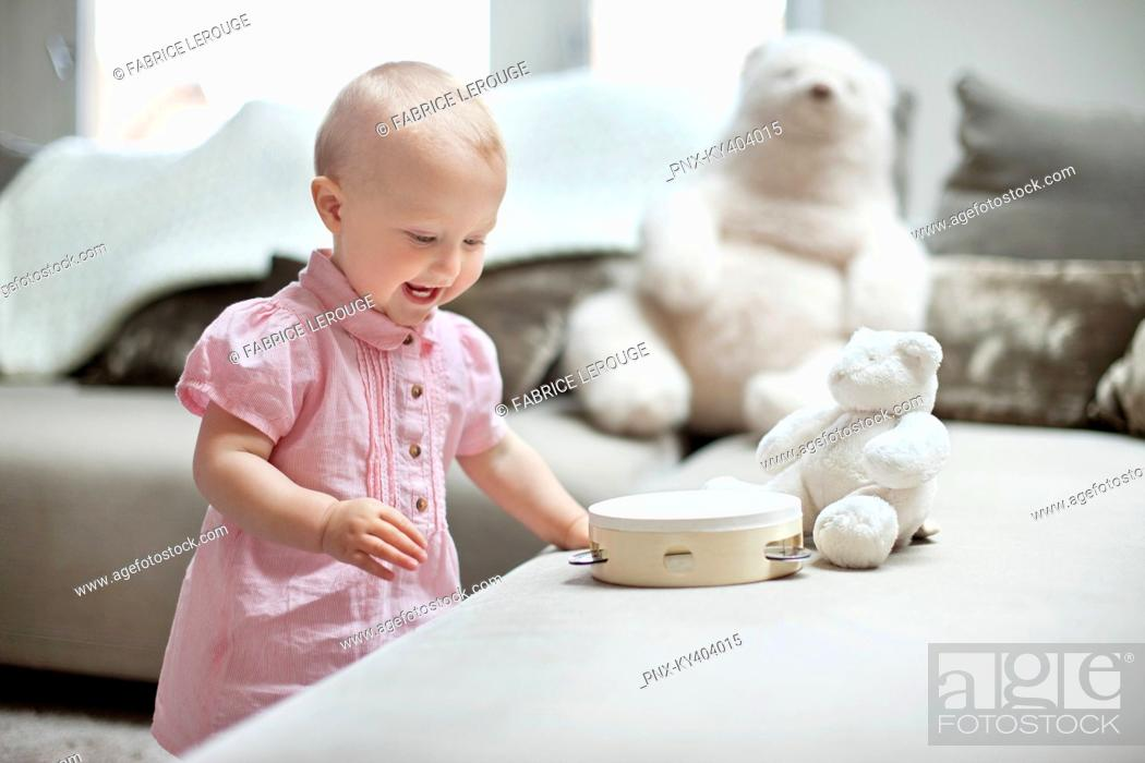 Stock Photo: Baby girl playing with toys.