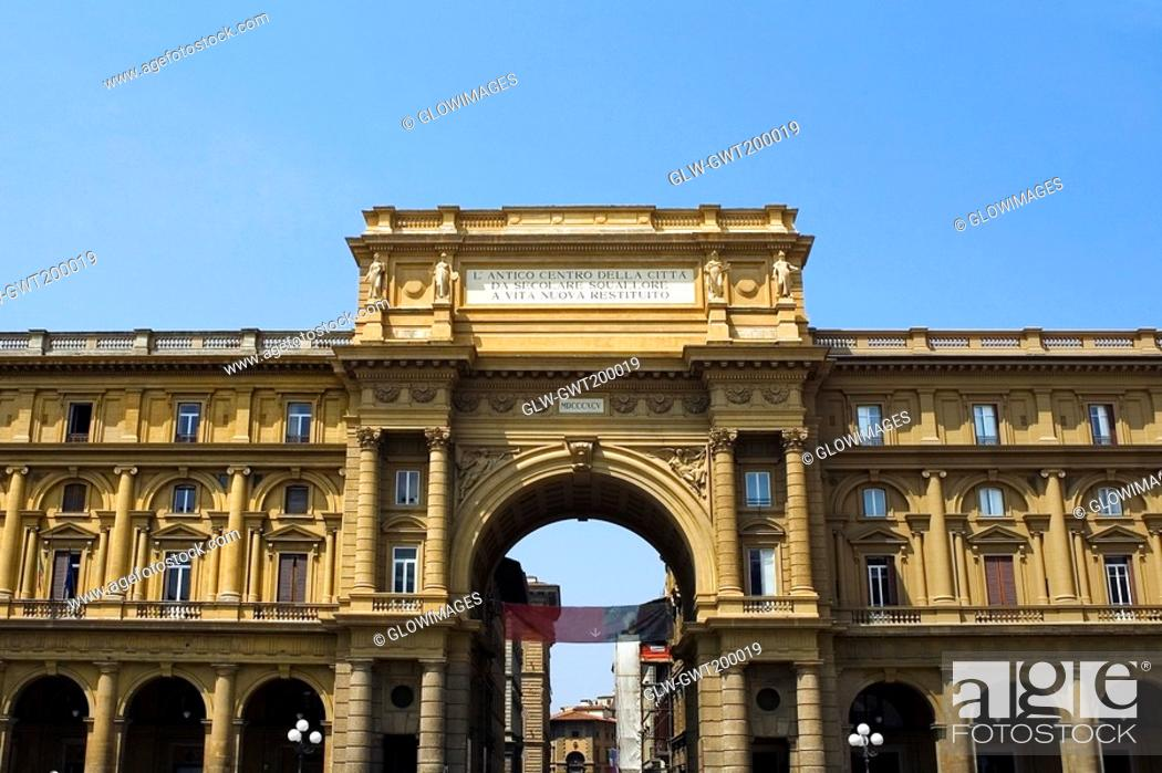 Stock Photo: Low angle view of the entrance gate of a market square, Uffizi Museum, Florence, Tuscany, Italy.