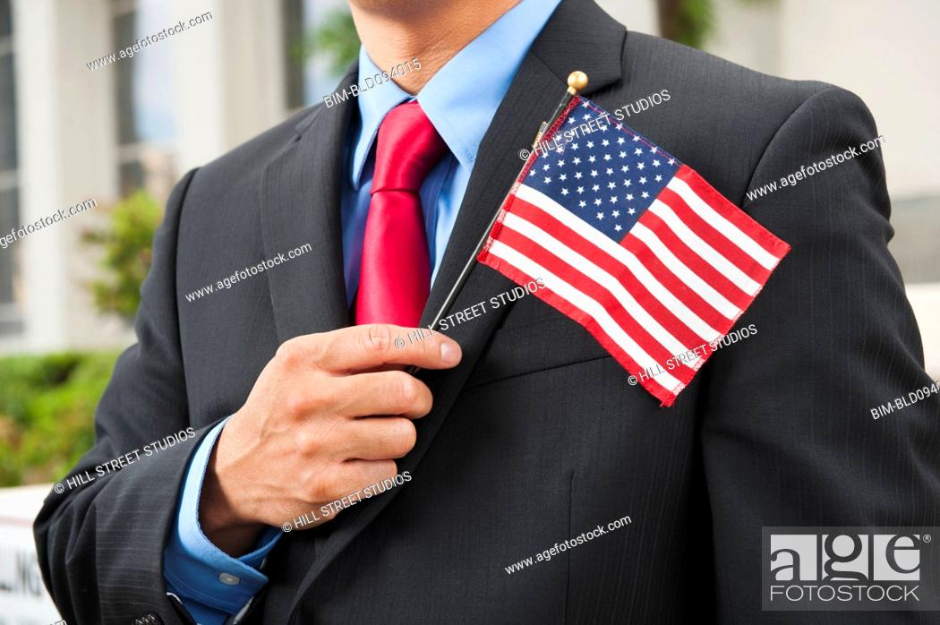 Stock Photo: Chinese businessman holding American flag.