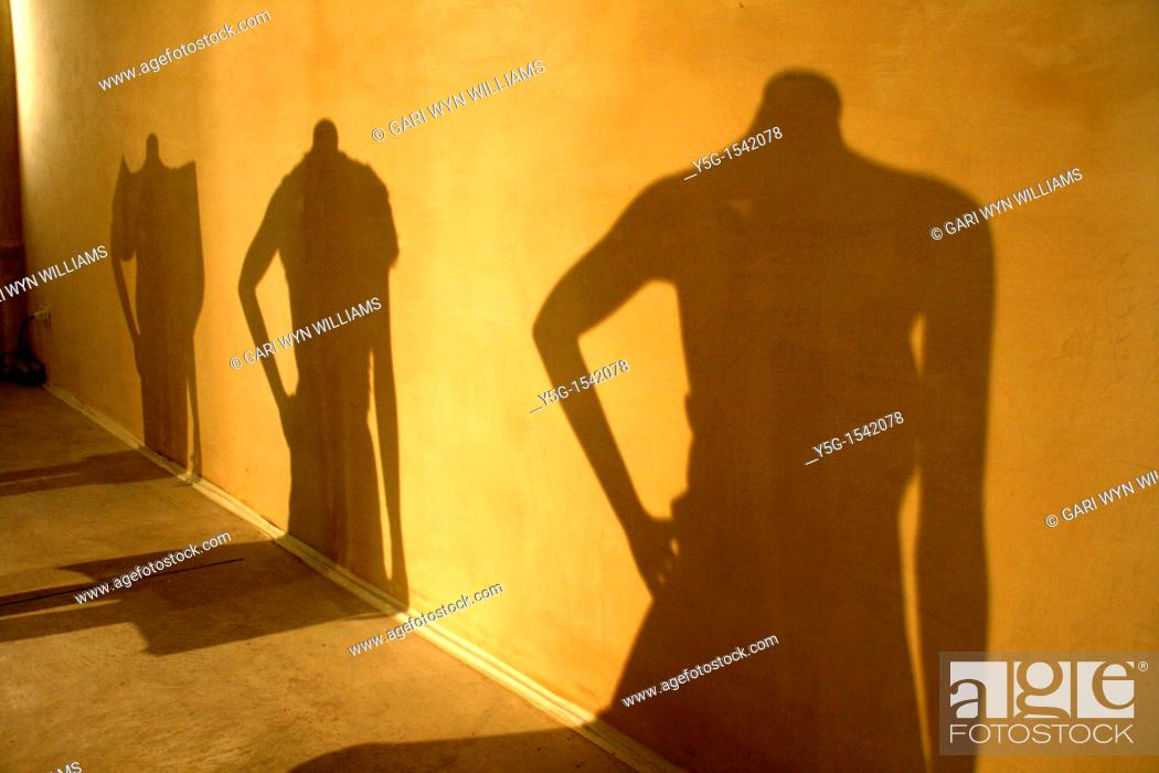 Stock Photo: shadow of female mannequins at fashion event.