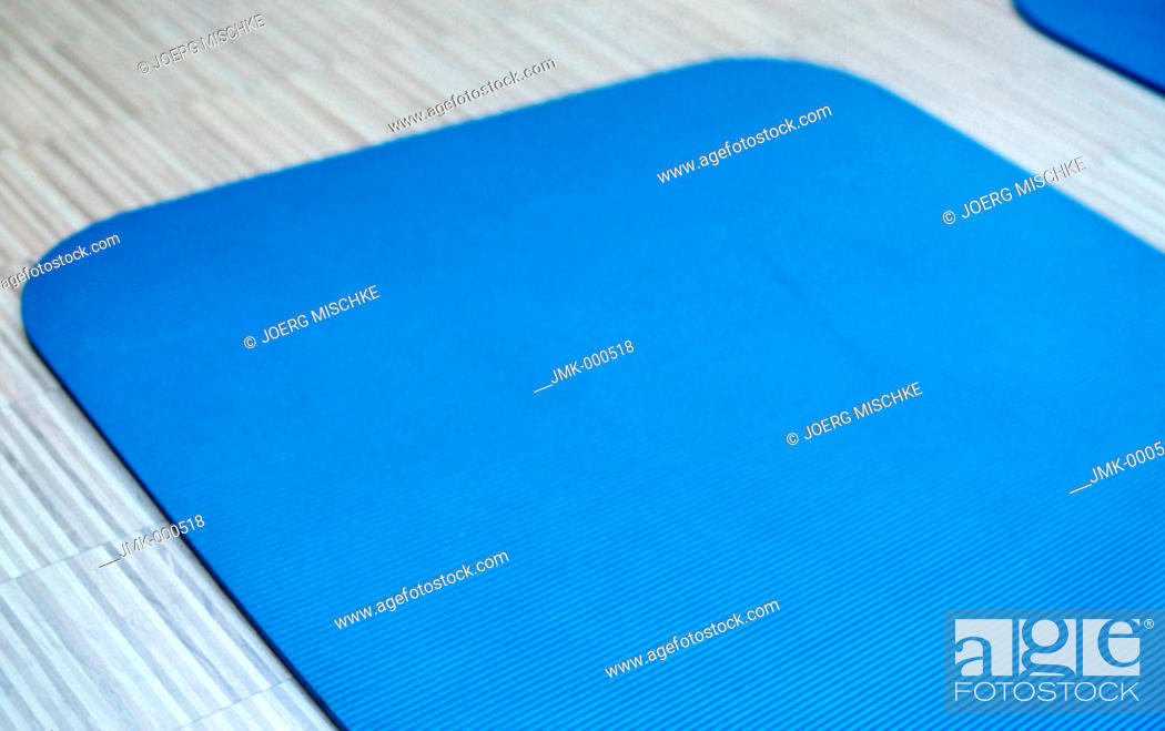 Stock Photo: Blue mat in a fitness room of a gym, fitness center.