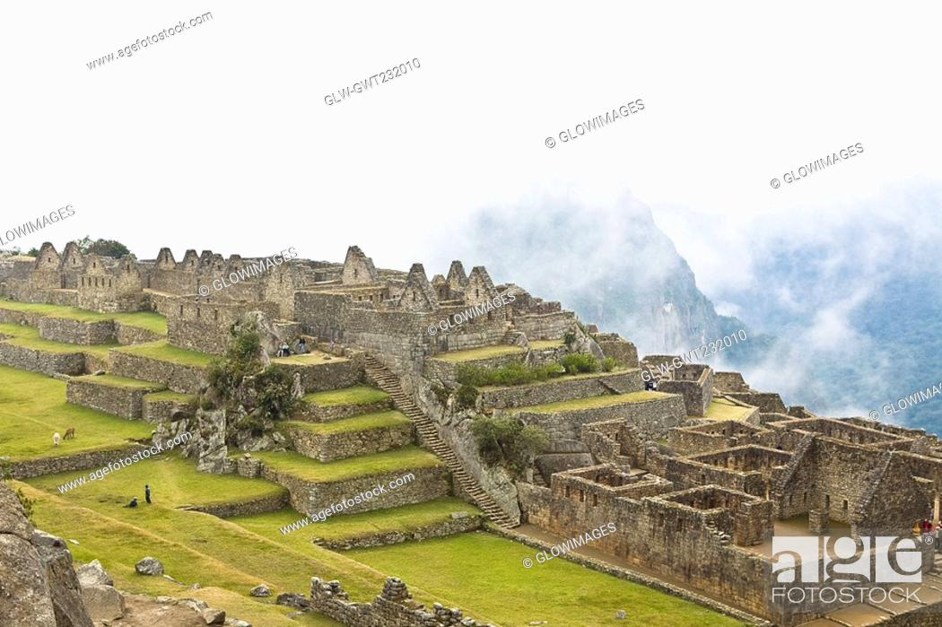 Stock Photo: High angle view of ruins on mountains, Machu Picchu, Cusco Region, Peru.