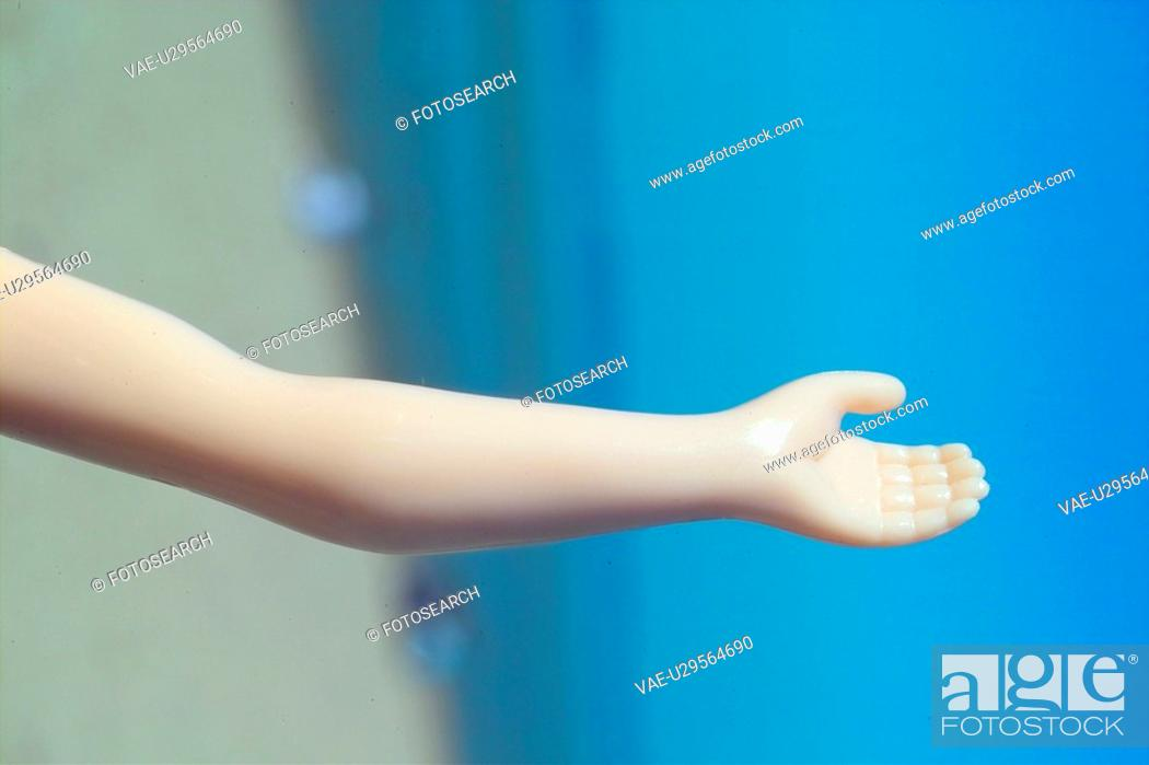 Stock Photo: hand, doll, body part, person, people, eye.