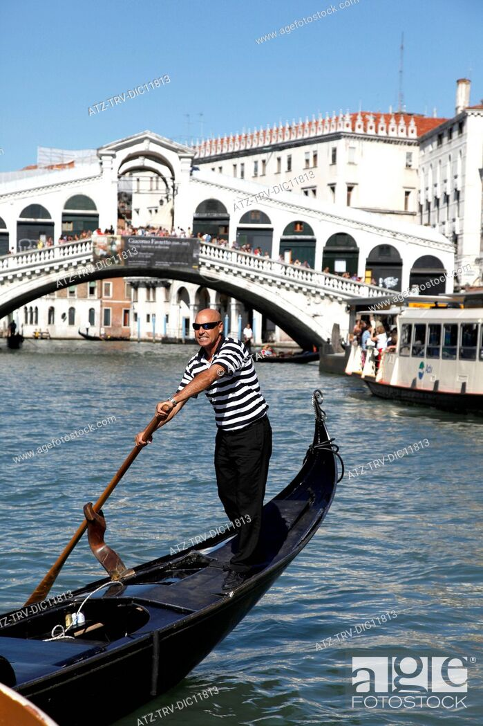 Stock Photo: GONDOLAS & RIALTO BRIDGE OVER GRAND CANAL; VENICE, ITALY; 11/09/2010.