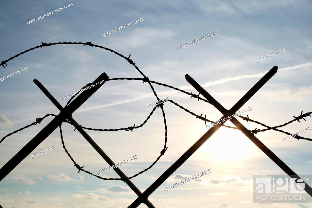 Stock Photo: barbed wire defence barrier outdoors by sea in italy.