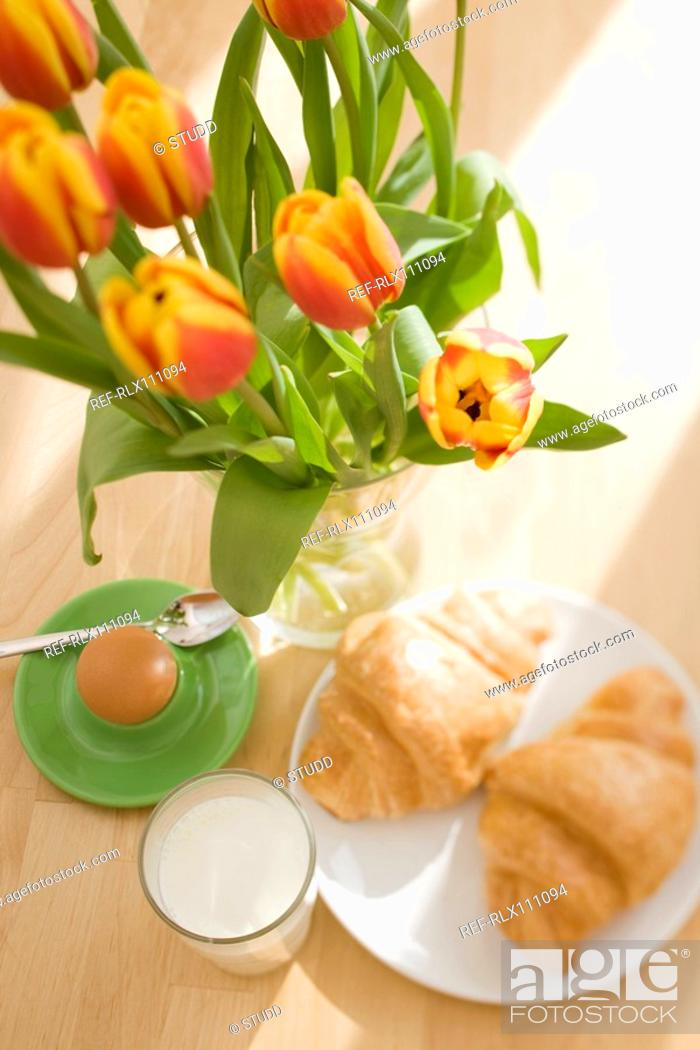 Stock Photo: Continental breakfast still life with flowers.