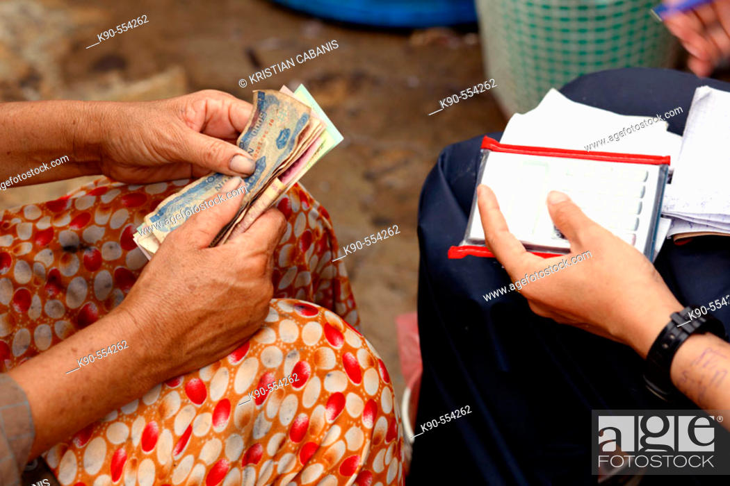Stock Photo: Two women counting the money (Vietnamese Dong) on the fresh food market of Hoi An, Vietnam, Southeast Asia.