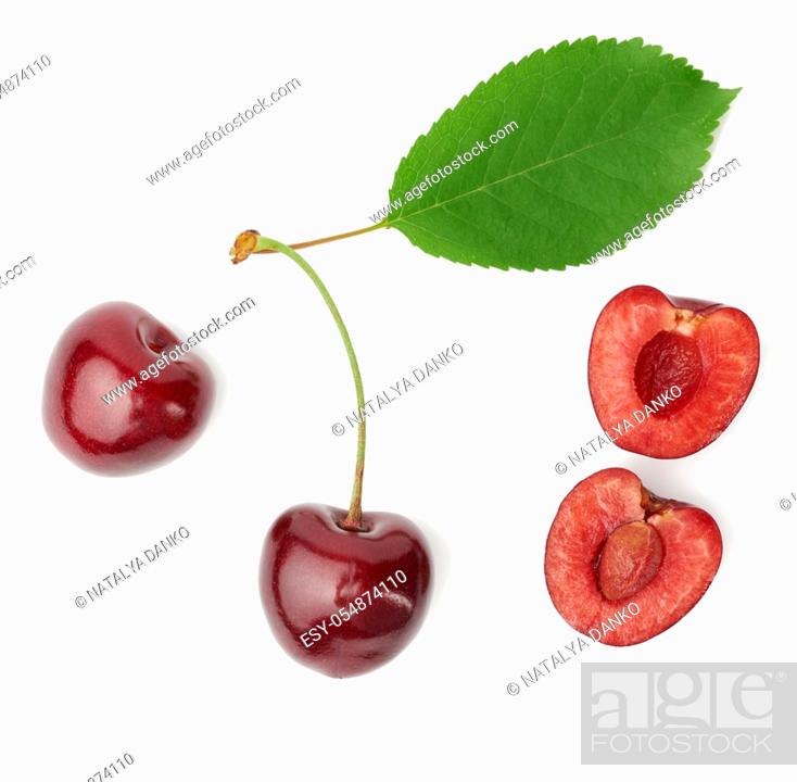 Stock Photo: whole ripe red juicy sweet cherries and halves with pits isolated on a white background, top view.