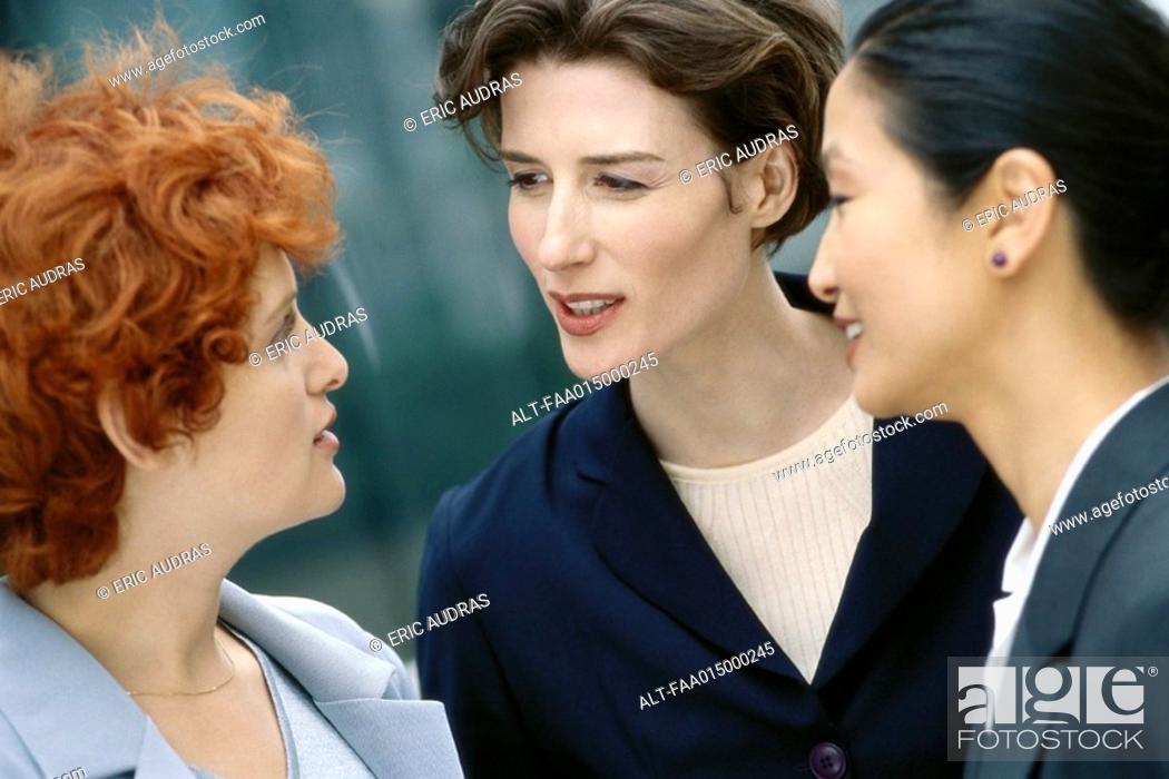 Stock Photo: Three businesswoman talking.