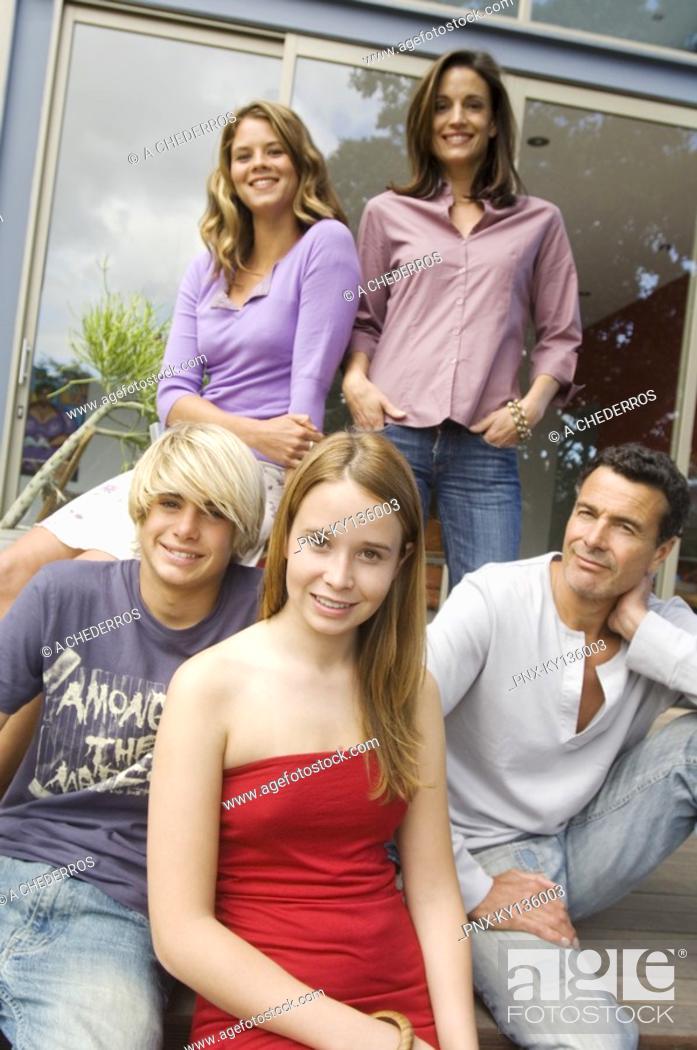 Stock Photo: Parents and three children teenagers, indoors.