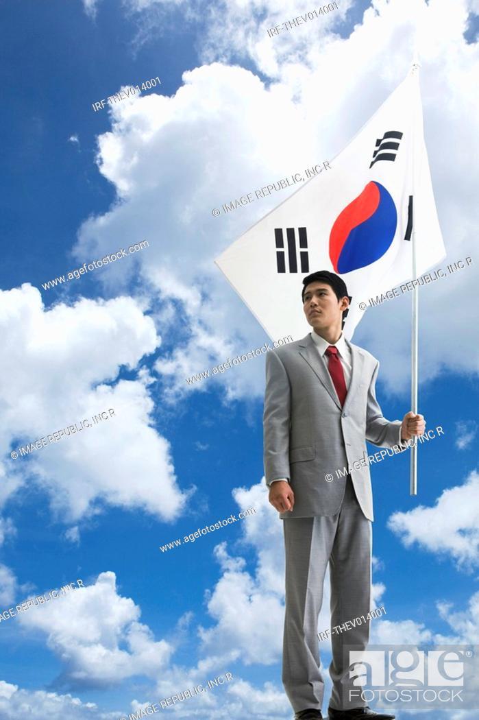 Stock Photo: businessman holing Korean flag, Taegeukgi.