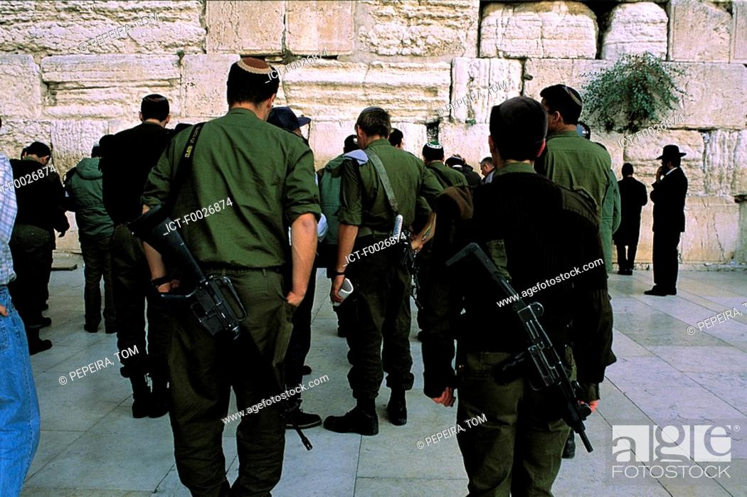 Stock Photo: Israel, Jerusalem, Jewish soldiers in front of the Western Wall.