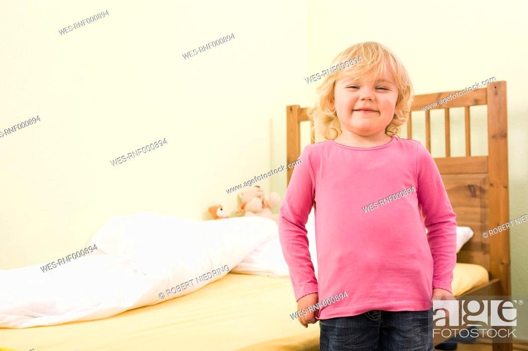 Stock Photo: Girl waking up, smiling.