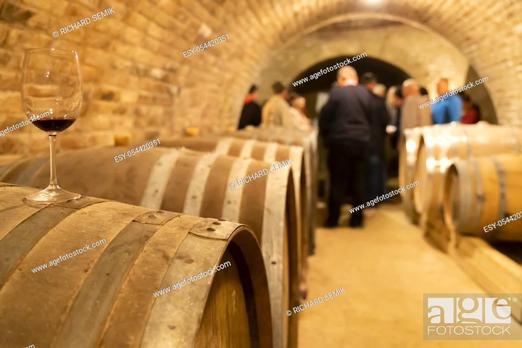 Stock Photo: glasses of wine on barrel, Szekszard, Hungary.