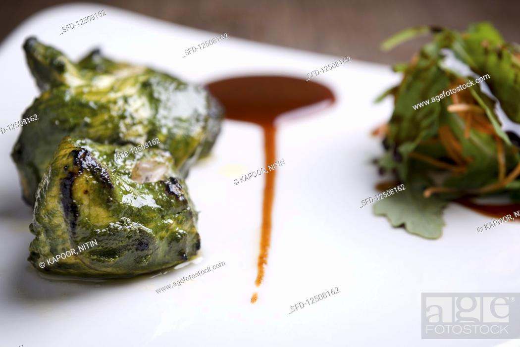 Stock Photo: Tandoori Salmon Tikka with Salad and Tamarind Chutney.
