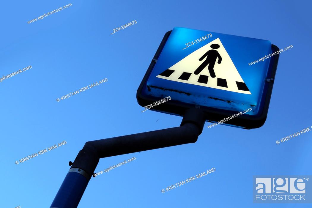 Stock Photo: Blue and white crosswalk sign tilted view.