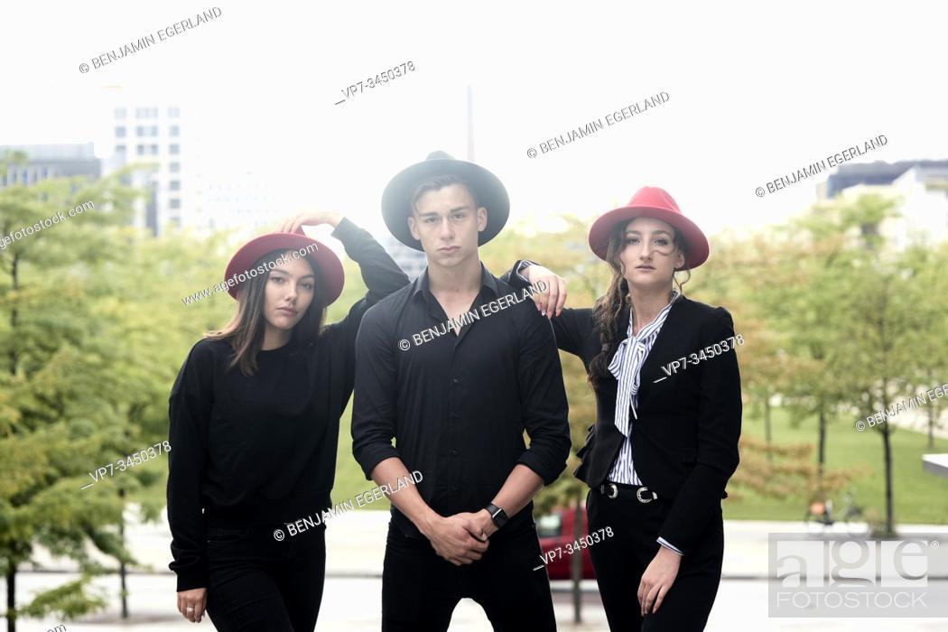 Stock Photo: Man and two women wearing hats. Munich, Germany.