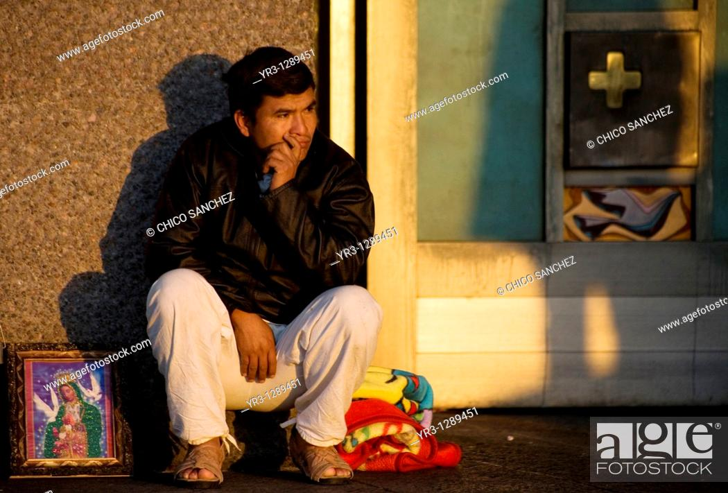 Stock Photo: A pilgrim sits at the entrance of the Our Lady of Guadalupe Basilica in Mexico City, December 4, 2010  Hundreds of thousands of Mexican pilgrims converged on.