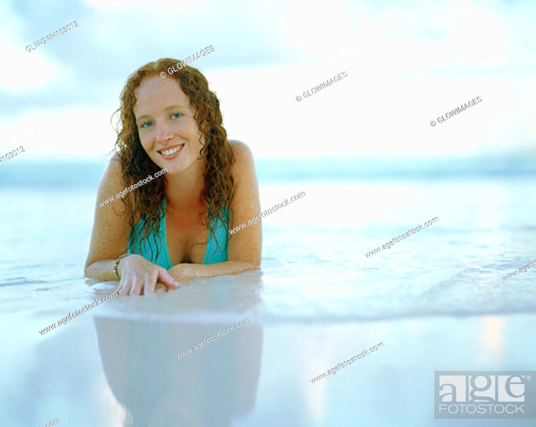 Stock Photo: Portrait of a young woman smiling on the beach, Bermuda.