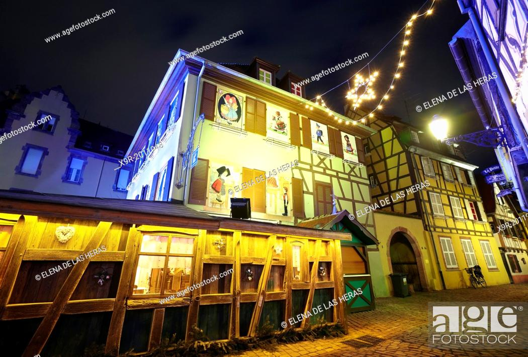 Stock Photo: Hansi drawings Christmas decoration by night at the Little Venice. Colmar. Wine route. Haut-Rhin. Alsace. France.