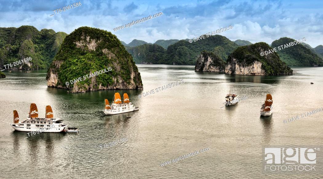 Stock Photo: traditional junks sailing in Halong Bay, Vietnam.