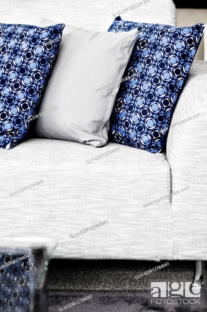 Photo de stock: Cushions on a couch.