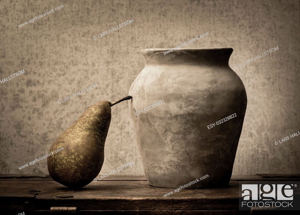 Stock Photo: Fruit still life with pear on wooden table. Vintage rustic food image with artistic texture effect.