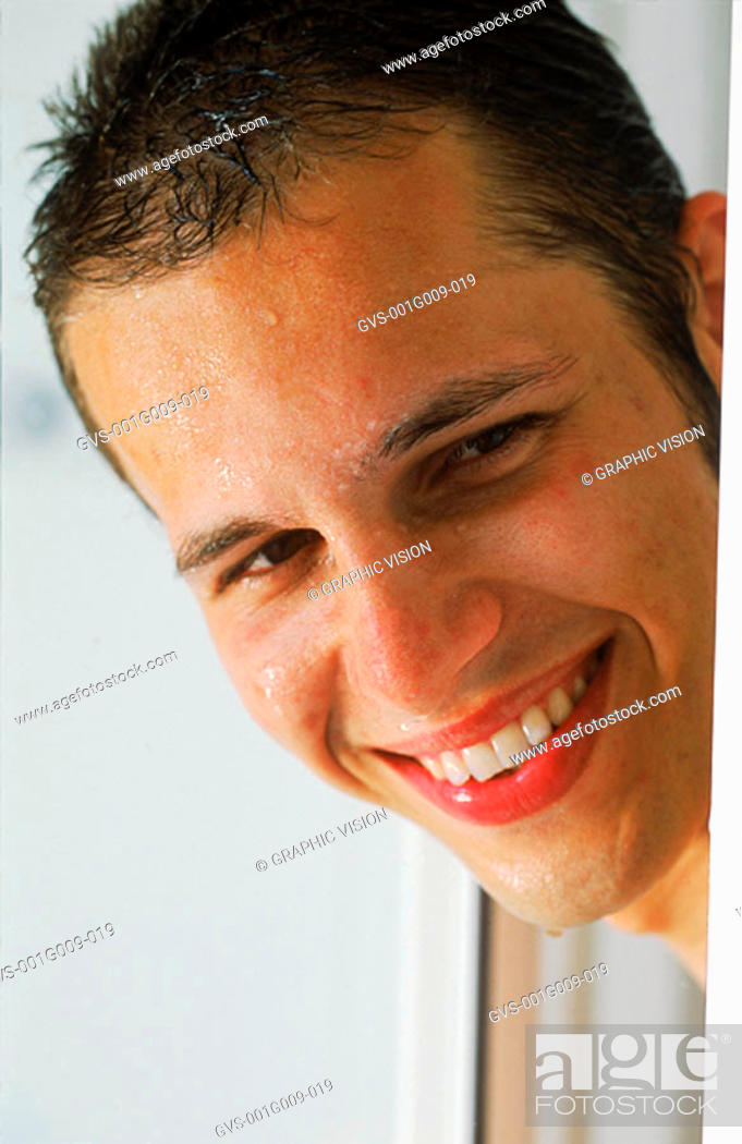 Stock Photo: Close-up of a young man with a wet face smiling.