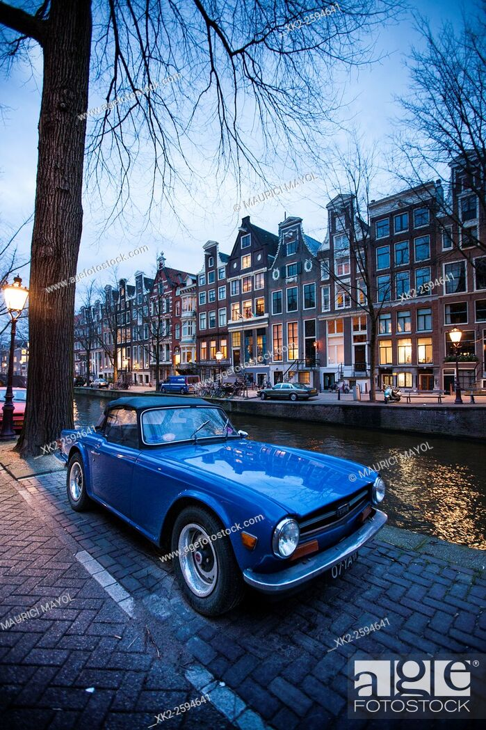 Stock Photo: Nice blue sport car parked at Leidsegracht canal, Amsterdam, The Netherlands.
