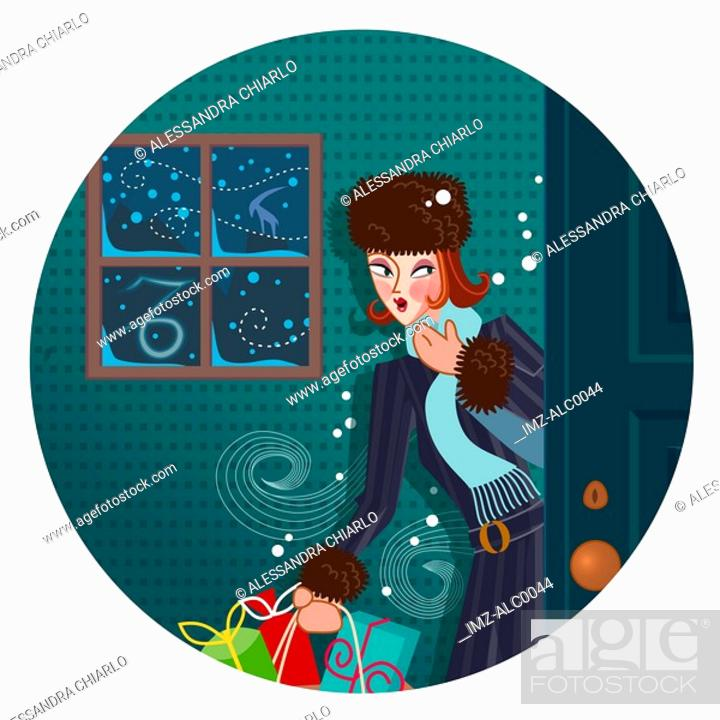 Stock Photo: A Capricorn woman coming in from the cold, holding bags of Christmas shopping.