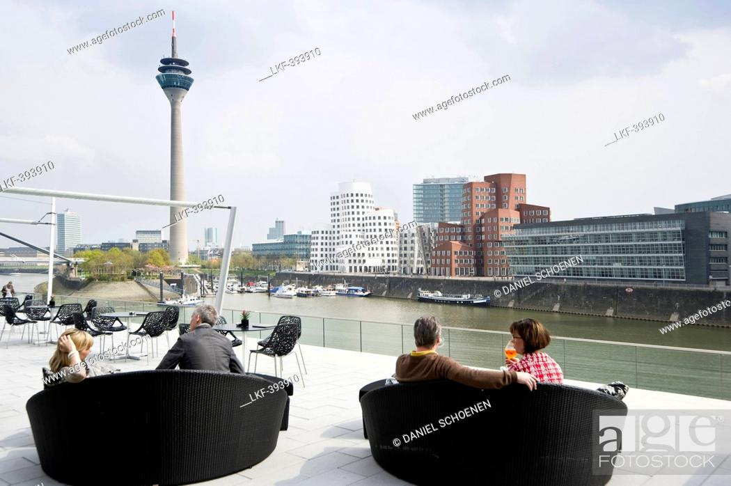 Stock Photo: Cafe at the Media Harbour, television tower and buildings designed by Frank Gehry, Duesseldorf, North Rhine-Westphalia, Germany, Europe.