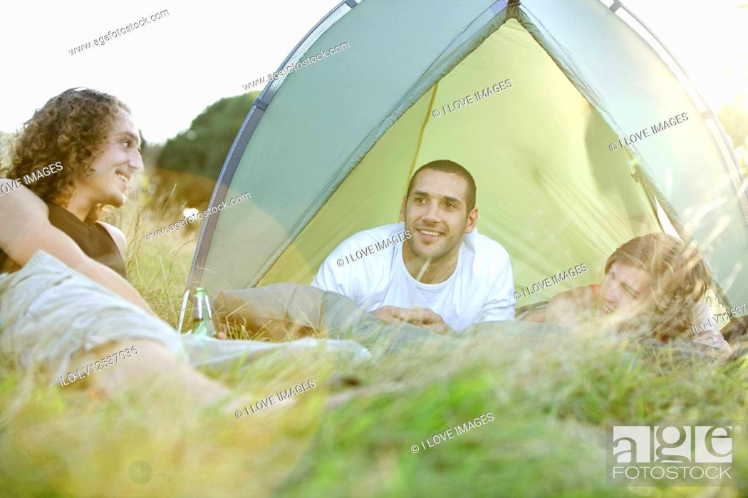 Stock Photo: Three young men camping.