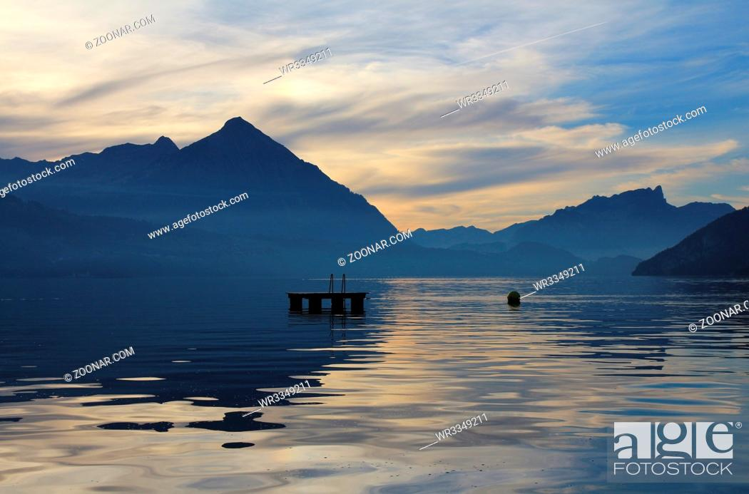 Stock Photo: Summer scene in the Swiss Alps. Lake Thunsersee and mount Niesen.