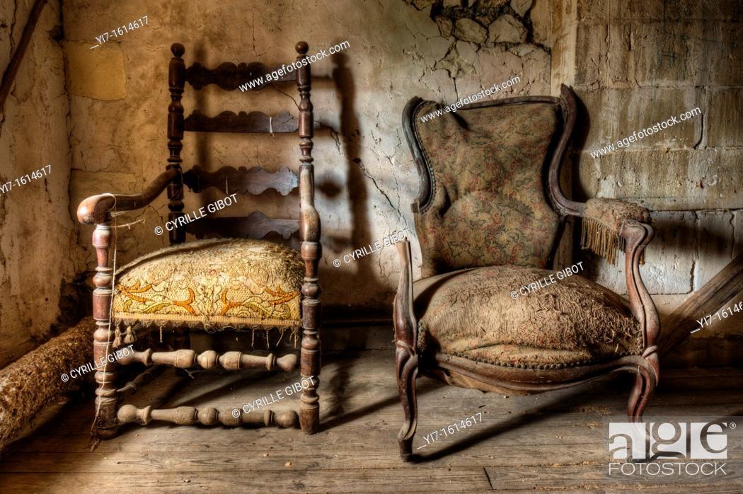 Stock Photo: Two broken armchairs.