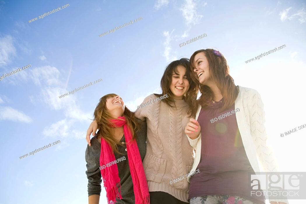 Stock Photo: Female friends, low angle view.