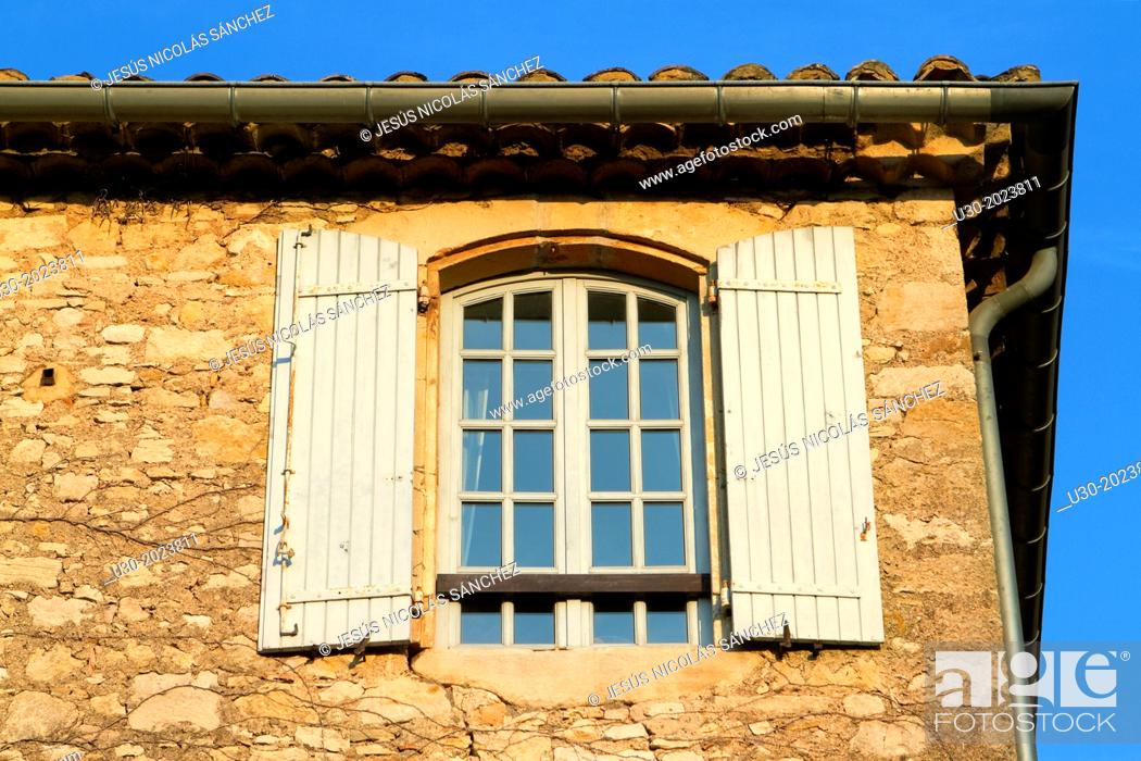 Stock Photo: Detail of a typical facade with window in Roque-sur-Ceze, labelled The Most Beautiful Villages of France. Gard deparment, Languedoc-Roussillon region.