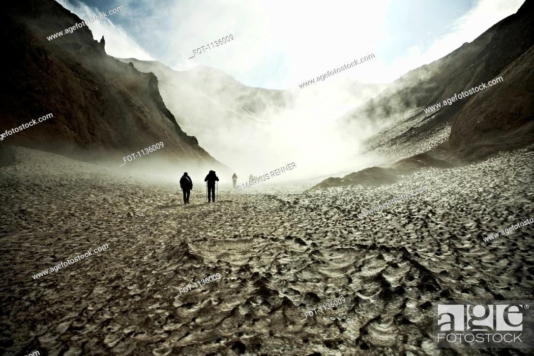 Stock Photo: Hikers trekking through the Mutnovsky Volcano, Kamchatka, Russia.