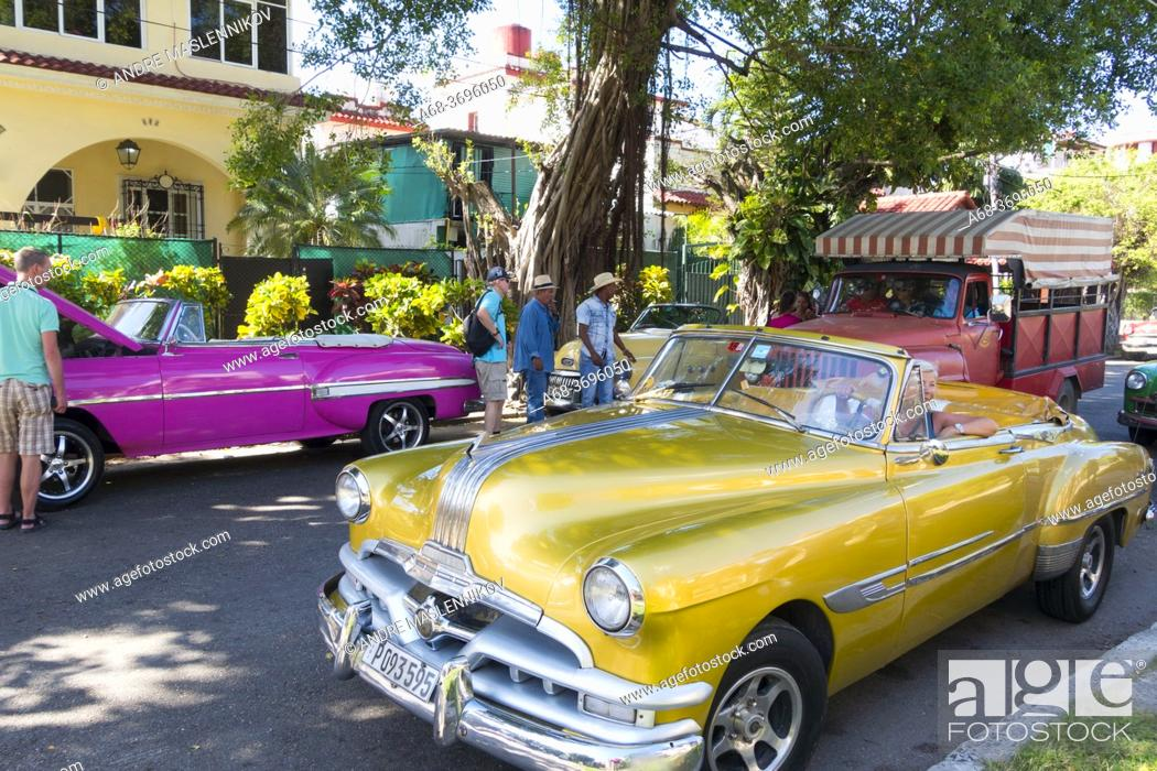 Stock Photo: American cars in Havana. Many are used as taxi.