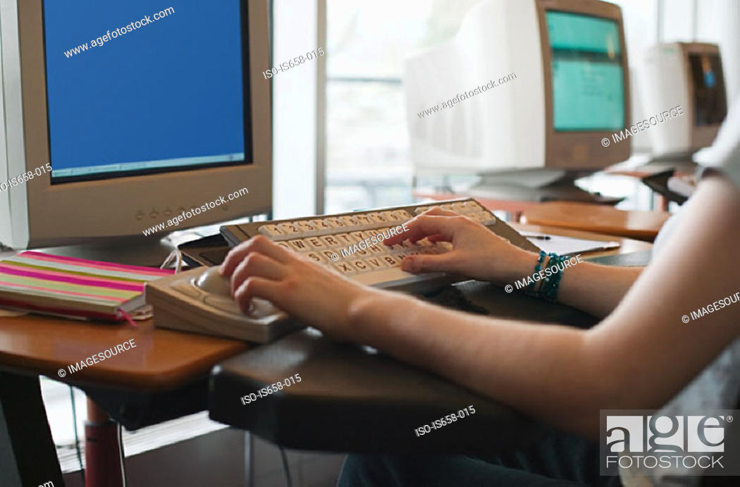 Stock Photo: Someone using a specially adapted computer.