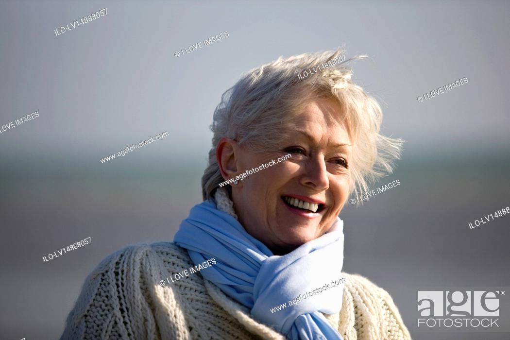Stock Photo: Portrait of a senior woman on the beach.