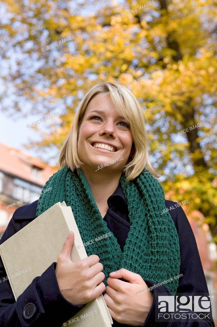 Stock Photo: College student on campus in autumn.