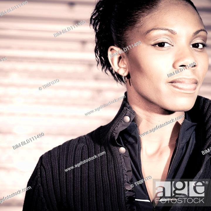 Stock Photo: African American woman standing by bleachers.
