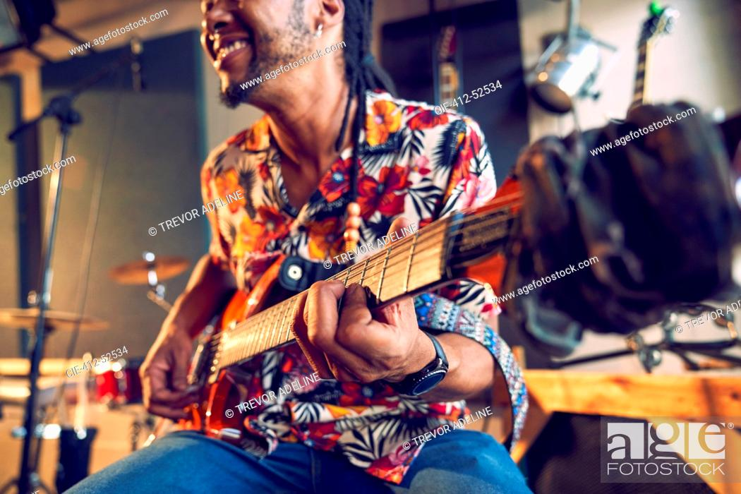 Stock Photo: Male musician playing electric guitar.