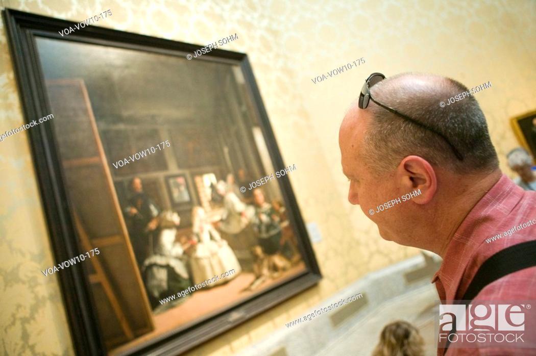 Stock Photo: Man looks at Las Meninas by Velazquez as shown in the Museum de Prado, Prado Museum, Madrid, Spain.