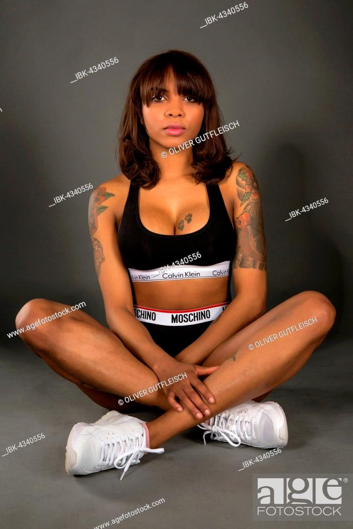 Stock Photo: Woman with tattoos in sporty outfit.