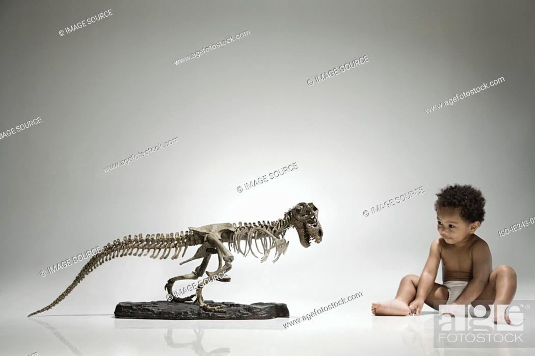 Stock Photo: Boy and a dinosaur skeleton.