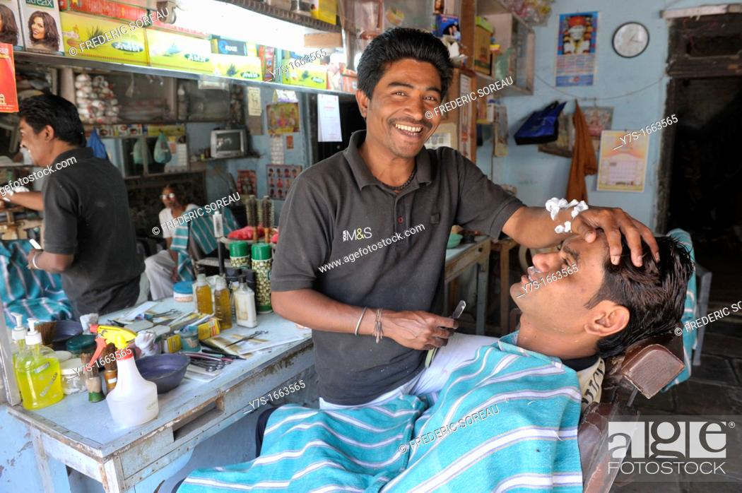 Stock Photo: Asia, India, Delhi, indian barber giving man a wetshave.