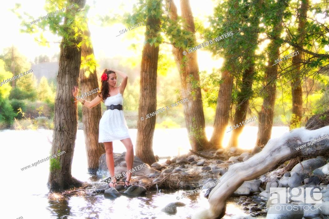 Stock Photo: A beautiful young caucasian woman outdoors in Spokane, Washington, USA, by the Spokane River.